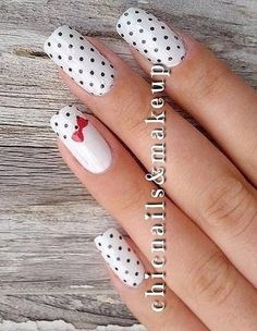 Marvelous Black Polka Dot Nails with White Base and Bow