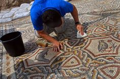 mosaic patterns | worker cleans the dirt off an ancient Roman mosaic as it is revealed ...