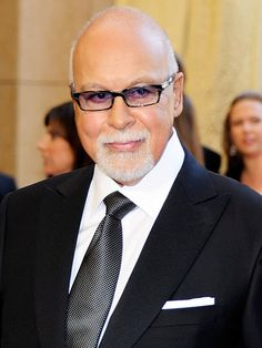 """RENÉ ANGÉLIL, 73. The singer turned manager discovered a then-unknown Céline Dion in 1980 — and made her into a superstar. They wed in 1994. """"I lost the love of my life,"""" Dion told PEOPLE."""