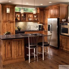 This Rustic Birch cabinetry with a Praline finish adds a rugged element to this modern kitchen.