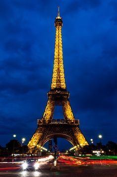 """L2M2AS1 - Part B (c) - """"blurred movement"""" - Canon 6D - manual mode, no flash, tripod, f18, iso100, 6 sec, 34mm, awb. Usinf the street lights behind me and the glow of the Eiffel Tower to illuminate the sky to show the storm clouds brewing. Used remote shutter release with IS off to reduce camera shake. Light trails from the cars acting as leading lines into the image"""