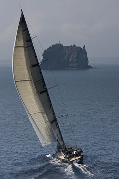 """'Rolex Volcano Race Day 3' Photo ~ """"DSK Pioneer Investments approaches Strombolicchio during the Rolex Volcano Race"""" *Capri, Italy* 