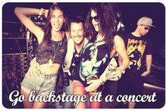 Go backstage at a concert.
