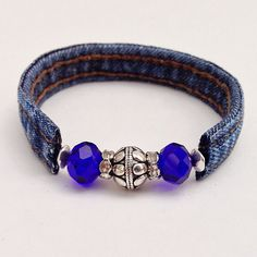 Denim Dark Blue Beaded Wrap Jean Bracelet, Recycled Upcycled Eclectic Wrap Cuff Braclet, Blue & Silver Beads Denim Seams by EverydayWomenJewelry on Etsy https://www.etsy.com/listing/234832404/denim-dark-blue-beaded-wrap-jean