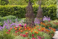 More of Sarah Raven's garden at Perch Hill. Love the twig tuteurs.