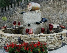 Red wine fountain outside the biggest wine cellars in the world in Milestii Mici, Moldova by gomeniuk