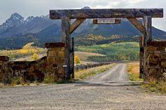 Driveway entrance post exterior Last Dollar Ranch entrance Driveway Landscaping, Driveway Gate, Front Gates, Entry Gates, Farm Entrance Gates, Ranch Fencing, Farm Gate, Long Driveways, Ranch Life