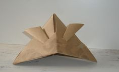 Looking for origami and papercraft activities for kids? This samurai hat is easy origami for kids . Click here to find out how to do origami.