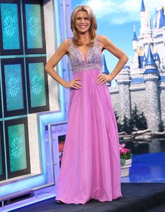 FAVIANA: Orchid chiffon gown, bodice embellished in silver & orchid beads & rhinestones, v-neckline w/illusion inset, illusion insets at bodice back, full multi-tier skirt  | Vanna White's dresses | Wheel of Fortune