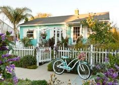 Turquoise house & bike --- makes me smile.