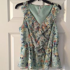 Laure Conrad peplum blouse. Size L Love this shirt it just does not fit me. I also have a listing for medium. Beautiful colors and ruffles. Great condition. Size L. LC Lauren Conrad Tops Blouses