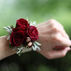 wrist corsage with Rubicon spray roses, buckeyes, dusty miller and seeded eucalyptus on a platinum pearl wristlet