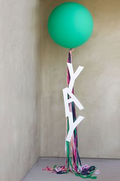 large round balloon table number with streamers