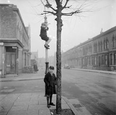 Nigel Henderson 'Photograph of two unidentified children, one of which is climbing a lamp-post', [c 1949–c 1956] ©  Nigel Henderson Estate