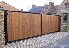 Steel framed timber clad automatic sliding gate