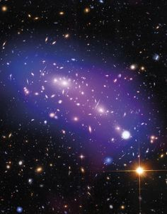 MACS J0416 is a pair of colliding galaxy clusters 4.3 billion light-years away that will eventually combine to form an even bigger cluster (nearly every object in this image is a galaxy). This image contains data in the X-ray (diffuse emission in blue), optical (red, green, and blue), and the radio (diffuse emission in pink) portions of the spectrum.