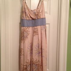 Great fall cream with flowers dress Dress has a chambray/blue waist band. Tan straps and accents. Blue and green, tam and black flowers. Dress has pockets too. Worn once jonathan martin Dresses