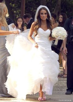 Matt Lanter married Angela Stacy in Malibu on Friday with family and friends watching. Angela wore an ivory gown with a full skirt and a strapless sweetheart neckline and kept her hair down in loose waves. She topped her look off with a long veil and shared a snap of the ensemble on her Twitter account. Matt and Angela held their reception at Calamigos Ranch, where guests got a chance to pose on a personalized red carpet with a group of robots.
