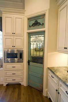 Vintage pantry door, loving the cabinets!