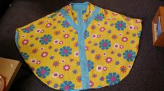 http://www.ebay.com/itm/VTG-CHASUBLE-CLERGY-VESTMENT-HANDMADE-FLOWER-POWER-BEAUTIFUL-COLORFUL-WHIMSICAL-/111988010337?hash=item1a13016d61:g:HisAAOSw1DtXK1j7