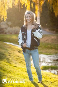 Wear your letterman jacket as a way to highlight your involvement in high school sports. #senioroutfit #seniors #seniorphotography
