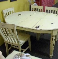 distressed table and chairs