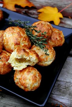 These are Cheddar-Thyme Gougères with creamy goat cheese filling!!   A little time consuming but really great Hors d'oeuvres  Makes about 4 dozen  Can be made ahead and frozen for one week prior to baking