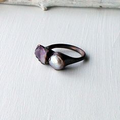 gorgeous.  copper, amethyst, pearl ring from midwest alchemy on etsy.