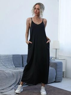 Style: CasualColor: BlackPattern Type: PlainNeckline: Spaghetti StrapLength: LongType: CamiDetails: PocketSleeve Length: SleevelessSeason: Spring/SummerComposition: 5% Spandex, 35% Cotton, 60% PolyesterMaterial: PolyesterFabric: Slight StretchWaist Line: NaturalSheer: NoHem Shaped: StraightFit Type: Loose Linen Dresses, Latest Dress, Comfortable Fashion, Dress P, Fashion News, Trending Outfits, Stylish, Clothes, Black Pattern