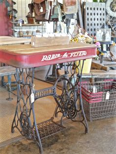 Antique sewing machine base with repurposed wooden top