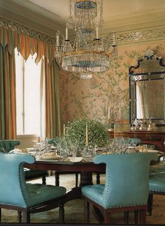 Albert Hadley dining room in pale peach and powder blue.  Beautiful chinoiserie wallpaper, crystal chandelier and Venetian mirror.  Home of Mr. and Mrs. Lawrence Brandt, Washington, DC.