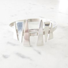 Victor Janson 'Vicson' vintage sterling silver bangle | Sweden | 1969 by KoruJewelleryCo on Etsy