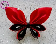 __This listing is for a very cute Kanzashi butterfly made of satin ribbon __Beautiful red and black colors  __Is 4. long and attached to a 2 long