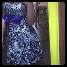 Zebra print dress with bow Super fun zebra dress with a purple bow. Only worn once. Jessica McClintock Dresses Strapless