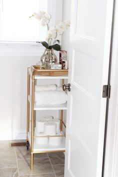 house of hire: Series- Shop Your Home: Part 2 ikea hack bar cart in bathroom for extra storage in a small space. Click to read more or pin and save for later!