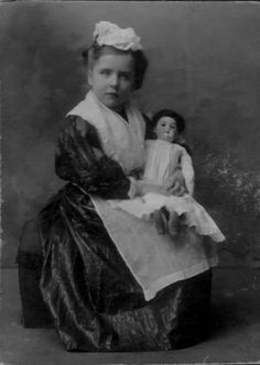 old photo of girl holding doll