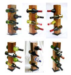 Réunissant lans aspect rustique du bois de grange altérés avec un sens moderne de conception, ces porte-bouteilles autoportantes sont fabriqués à partir de pièces acier et solides de bois récupéré. En toute sécurité, chacun détient quatre bouteilles de vin standards 750 ml et vous