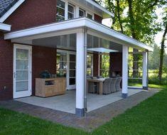 Vrijstaande woning met praktijkruimte in jaren 30 stijl - veranda