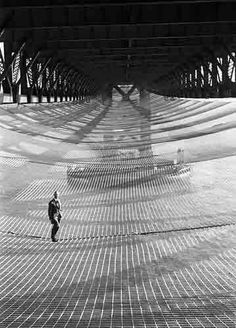 """Safety net placed under the Golden Gate Bridge during construction in the 1930s. Its presence saved 19 lives.   These would-be survivors became known as the """"Halfway to Hell Club""""."""