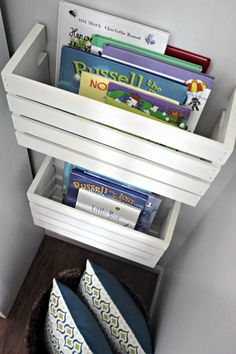 We love organization that doubles as display. Cut wooden crates in half and attach to the wall to display childrens books (and keep them off the floor!)