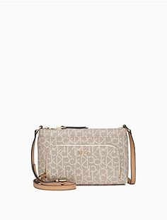 3ff96411fef9 this compact crossbody bag features subtly textured water resistant  material, an allover monogram design,