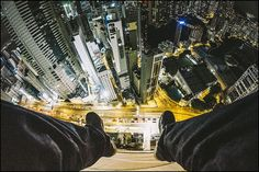 Don't look down ! Rooftopper Andrew Tso scales tall buildings in Hong Kong,   Canada and indonesia