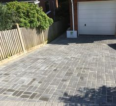 Charcoal block pavior driveway on a gradient with drain channel & aquacell soakaway Driveways, Tile Floor, Garden Design, Charcoal, Channel, Deck, Building, Outdoor Decor, Home Decor