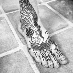 """An empowered foot. The runes are bound to give adventure and """"Walk the earth in the shadow of Yggdrasil in peace"""". #dotwork #rune #futhark #viking #vikingtattoo #thundermark #perun #bindrune #sirun #feigr #meatshoptattoo #futhark #nordic #nordictattoo #norrøn #yggdrasil #barcelona #barcelonatattoo"""