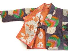Reversible and made from vintage quilts.