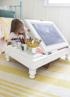 How to take a $15 cabinet and turn it into a child's desk that has cut-outs for back-to-school supplies, and opens to reveal storage for books and papers.