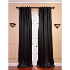 These sleek jet black curtain panels offer a fabric made of special polyester yarn that provides complete lighting blackout and superior insulation for any room. These curtains feature superior fabric softness and redefined texture.