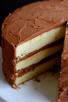 3 - Round Pans - Classic Yellow Cake with Chocolate Frosting. This yellow cake recipe is a gem, so moist and buttery, and the chocolate frosting is whipped to perfection! Cupcakes, Cupcake Cakes, Just Desserts, Dessert Recipes, Cheesecake Recipes, Yellow Butter Cake, Sour Cream Yellow Cake Recipe, Yellow Cakes, Yellow Cake Mixes