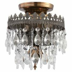 """Openwork semi-flush mount with hand-cut crystal beads.  Product: Semi-flush mountConstruction Material: Steel, glass and crystalColor: Antique brass and Roman bronzeFeatures:  Clear hand-cut crystalsDecorated with swivel glassUL and CUL listed120 Volts Accommodates: Small: (2) 60 Watt candelabra bulbs - not includedMedium: (3) 60 Watt candelabra bulbs - not includedLarge: (5) 60 Watt candelabra bulbs - not included  Dimensions:Small: 9"""" H x 8"""" DiameterMedium: 12"""" H x 12"""" DiameterLarge: 13""""…"""