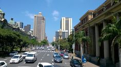 Looking westward up Dr Kaseme St, Durban (West Street). Taken from Durban Tourism Rickshaw bus. Durban City hall to the left Building Concept, South Africa, Tourism, Skyline, Street View, Memories, Architecture, City, Turismo